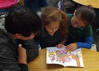 teacher taking on role of coach in peer tutoring